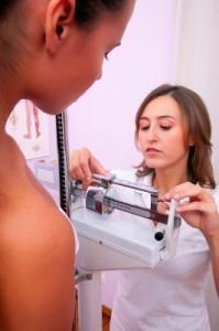 nurse weighing patient